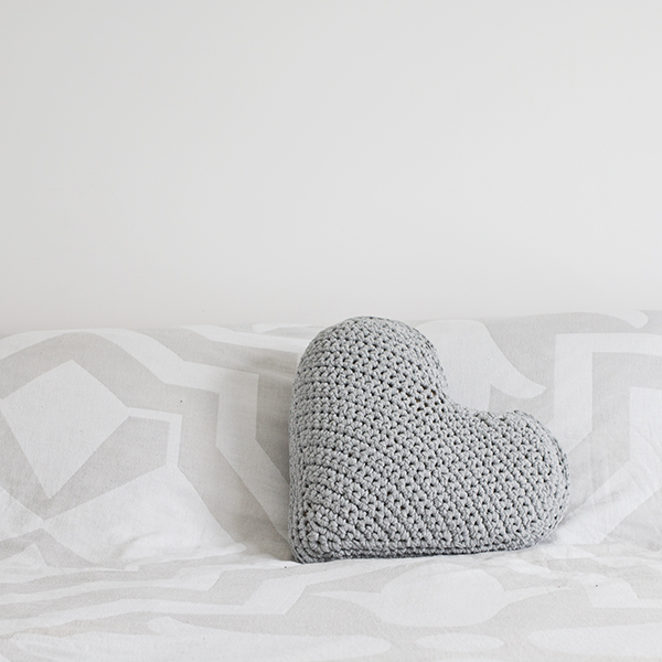 heart shaped pillow in grey